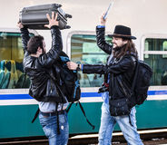Two guys are fighting because they missed their train. Royalty Free Stock Photos