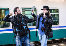 Two guys are fighting because they missed their train. Stock Images