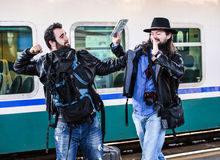Two guys are fighting because they missed their train. Royalty Free Stock Photography