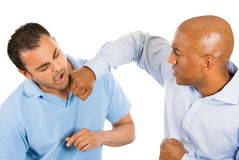 Two guys fighting, one guy punches, other guy falls back Royalty Free Stock Image