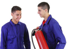 Two guys with a fire extinguisher Royalty Free Stock Images