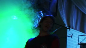 Two guys of the friend vigorously dance at a party. People dancing in a nightclub at a party. Men and women having fun, drink alcohol, get acquainted. The crowd stock video