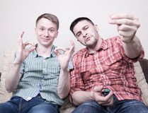 Two guys with funny gestures Stock Photos