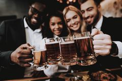 Two Guys. Girls. Chin-chin. Nightlife. Beer. Bar. Two Guys. Girls Chin-chin. Nightlife Beer Bar Rest. Drink Alcoholic Beverages Different Races Communicate royalty free stock photography