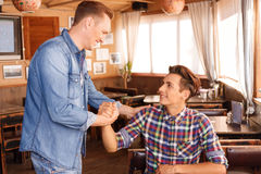 Two guys greeting each other Royalty Free Stock Photography