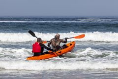 PEOPLE ON KAYAK ON THE OCKEAN royalty free stock photography