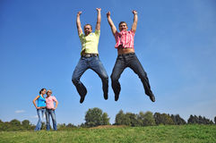 Two guys are jumping with their hands up Stock Photography