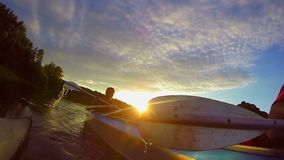 Two guys kayaking at sunset, sport, action camera, traveling. Stock footage stock video