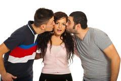 Two guys kissing friend woman Stock Photo