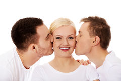 Two guys kissing friend woman cheeks Royalty Free Stock Photos