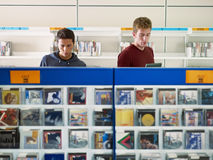 Two guys listening music in cd store Stock Image