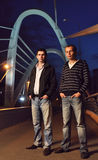 Two guys on the night bridge Royalty Free Stock Images