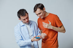Two guys with the phone Royalty Free Stock Photos