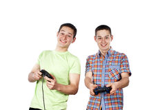 Two guys play computer games on the joysticks Royalty Free Stock Images