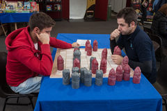 Two guys play a table game at Festival del Fumetto convention in Milan, Italy Royalty Free Stock Image