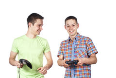 Two guys are playing computer games Stock Image