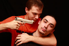 Two guys playing with gun Stock Images