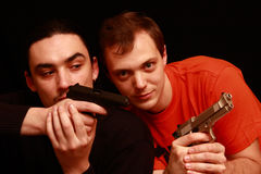 Two guys playing with gun Royalty Free Stock Photography