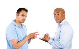 Two guys playing paper, rock, scissors. Royalty Free Stock Photo