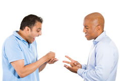 Two guys playing paper, rock, scissors. Stock Image