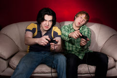 Two guys playing video games Royalty Free Stock Image