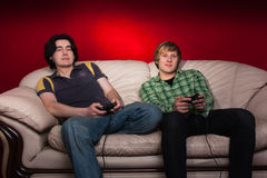 Two guys playing video games Royalty Free Stock Images
