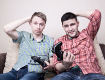 Two guys playing video games Royalty Free Stock Photos