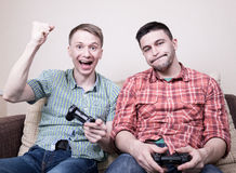 Two guys playing video games Stock Photography