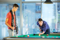 Two guys in pool billiard club playing pool billiard Stock Images