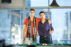Two guys in pool billiard club playing pool billiard Stock Photos