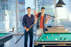 Two guys in pool billiard club playing pool billiard Royalty Free Stock Photography