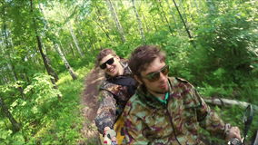 Two guys on quad ride through the forest. Two guys on yellow quad ride through the forest stock footage