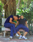 Two guys are resting on bench in park of Hanoi Stock Photos