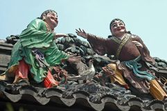 Two Guys on a Roof. Two guys and a bird, on a temple roof, Shanghai stock photos