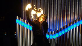Two guys show tricks with fire poi. On the fire show stock video footage