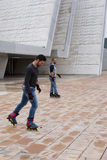 Two guys skating in-line in the street. In Spain Stock Image