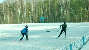 Two guys skiing with speed at stadium stock video
