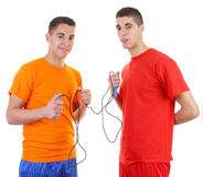 Two guys with a skipping rope stock images