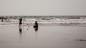 Two guys spinning around in the sea Stock Photo