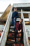 Two guys stand in an abandoned building Stock Photography