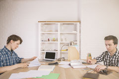 Two guys studying for exam Royalty Free Stock Photography