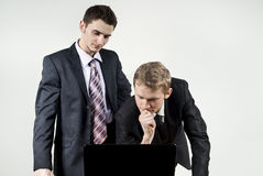 Two guys are thinking in front of computer Stock Photo