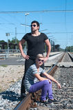 Two guys on train tracks Royalty Free Stock Images