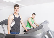 Two guys on treadmill Royalty Free Stock Photo