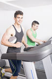 Two guys on treadmill Royalty Free Stock Photos