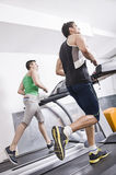 Two guys on treadmill Royalty Free Stock Images