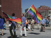 Two Guys walking with Pride flags at Indy Pride Royalty Free Stock Photography