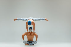 The two gymnastic acrobatic caucasian men on balance pose Stock Photos