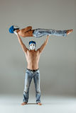The two gymnastic acrobatic caucasian men on balance pose Royalty Free Stock Photography