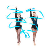 Two gymnasts dancing with blue ribbons Stock Photos